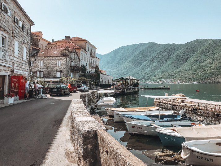Main street in Perast next to the water