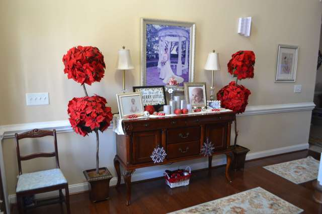 I love these poinsettia trees! They had such a fun and festive touch to the Christmas Decor in this foyer.