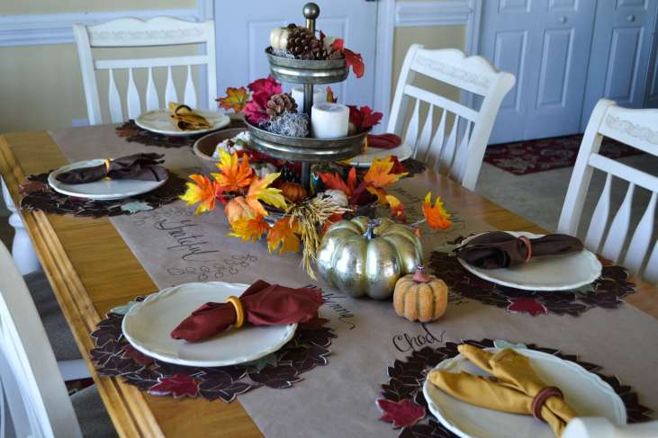 Love this beautiful tablescape for Fall. Can you go wrong with a galvanized three tired tray and hand lettered wrapping paper runner?