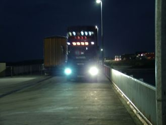 A loaded truck comes down the pier