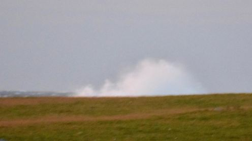 Waves breaking above the headland at Scarinish
