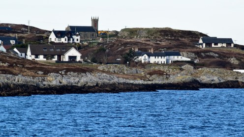 The view from the loch as the ferry approaches Coll