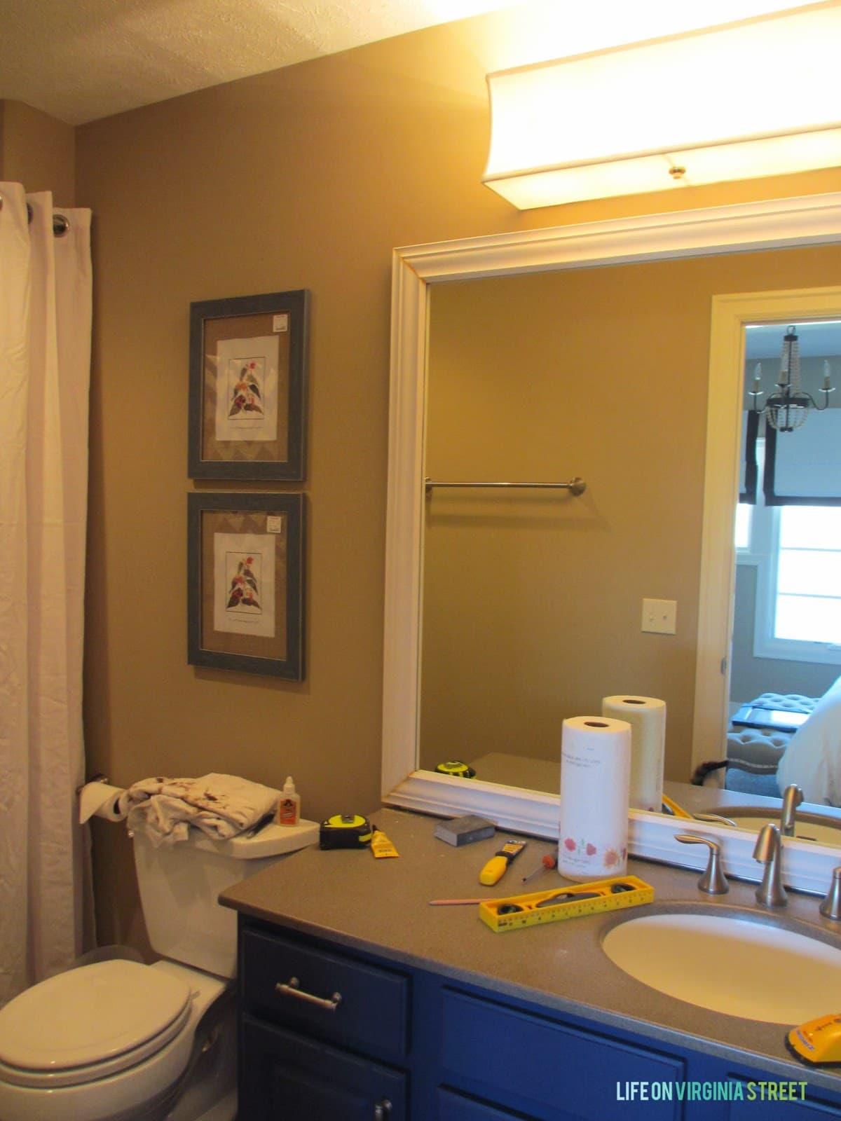 Guest Bathroom Lighting and Framing a BuilderGrade Mirror Details  Life On Virginia Street