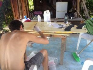 Fixing surfboard on patio