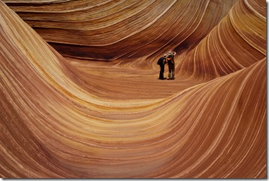 A couple photographing The Wave