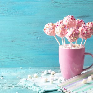 Cup filled with pink, beautiful cookie pops