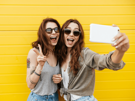 Women taking a video together