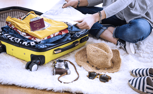 Woman packing clothes for a vacation