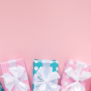 Wrapped presents with a pink background