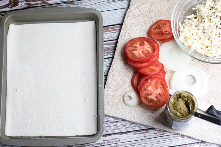 savory puff pastry with pesto, tomato and onion
