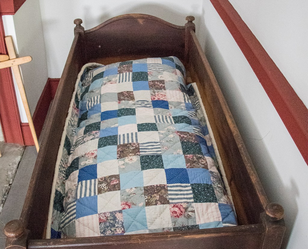 An 18th century baby cradle and quilt found in the Cossit House Museum, Sydney, Nova Scotia. Sydney Nova Scotia has many fine historic Colonial homes in that have been designated as a heritage property. Photo Credit: Wendy Nordvik-Carr©