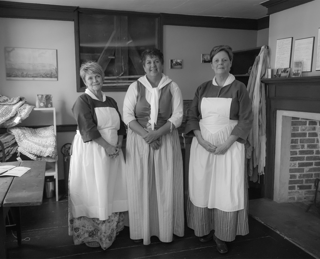 Cossit House Museum staff dressed in period costume demonstrate traditional skills like candle-making, lace-making and butter-churning. The Cossit House Museum is located in Sydney, Nova Scotia. Photo Credit: Wendy Nordvik-Carr©