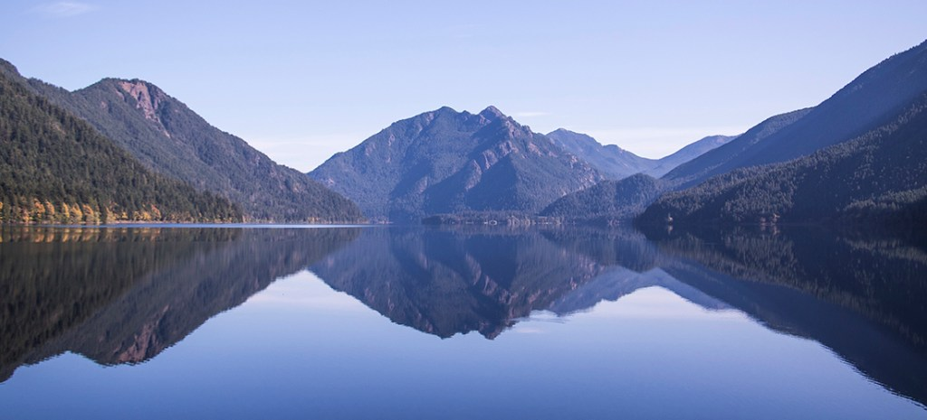 The reflective beauty of pristine Crescent Lake can be found in Olympic National Park, at the foothills of the Olympic Mountains on the Olympic Peninsula of Washington State. The historic Crescent Lake Lodge sits on the shore of the lake and Port Angeles is 17 miles away. Photo credit: Wendy Nordvik-Carr ©