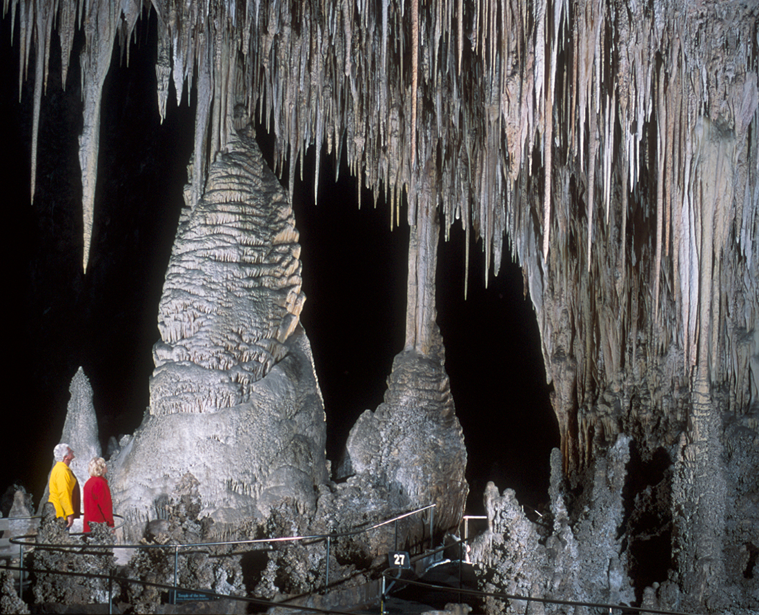 Carlsbad Caverns National Park - Temple of the Sun features a column surrounded by hundreds of stalactites. The surrounding area is one of the most heavily decorated places in the Big Room. Photo Credit: NPS Peter Jones