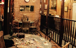 The Bird Cage Theatre operated for eight years. 1881-1892. This poker table is in the basement of the theatre. The longest-running poker game in history was played here. Doc Holliday, Bat Masterson, Diamond Jim Brady were some of the participants. Photo Courtesy of the Tombstone Chamber of Commerce.