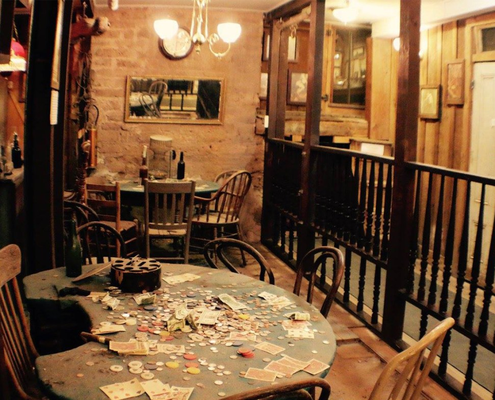 The famous poker table in the basement of the Bird Cage Theatre. The longest-running poker game in history was played here. Doc Holliday, Bat Masterson, Diamond Jim Brady were some of the participants. Photo Courtesy of the Tombstone Chamber of Commerce.