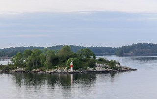 The world's largest group of islands in Archipelago National Park vary in size. Baltic cruise ships glide slowly as they navigate their way through the intricate network of islands in the waters between Helsinki, Finland and Stockholm, Sweden. Photo Credit: Wendy Nordvik-Carr