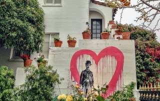 One of the top things to do in Carmel-by-the-Sea - Charlie Chaplin graces the wall of the courtyard at the historic Cypress Inn built in 1928. Photo Credit: Wendy Nordvik-Carr©