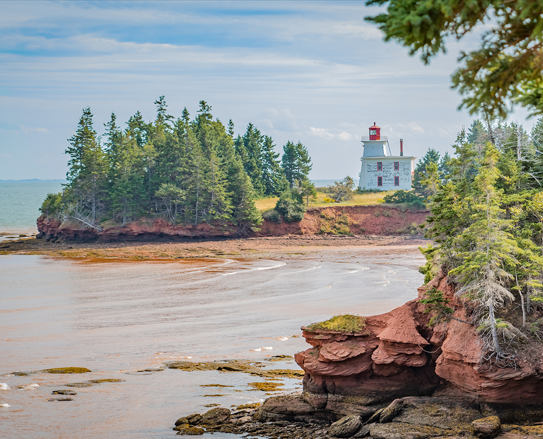 PEI scenic Red Sands Shore drive to Fort Amherst National Historic site and Blockhouse Point Lighthouse (1876) takes you on red clay roads winding through the countryside of farmlands, rolling hills and woodlands and then onto impressive red sandstone cliffs and red sand beaches. Irish Moss can be found here. Photo Credit: Wendy Nordvik-Carr