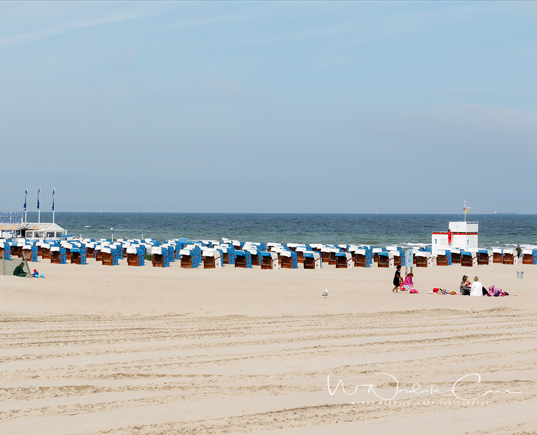 Wooden beach lounge chairs line the popular seaside resort fine white sand beach in Warnemünde, Germany, near Rostock. Photo Credit: Wendy Nordvik-Carr