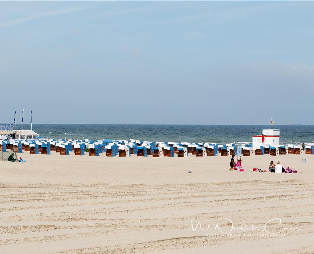 Wooden beach lounge chairs line the popular seaside resort fine white sand beach in Warnemünde, Germany, near Rostock. Photo Credit: Wendy Nordvik-Carr