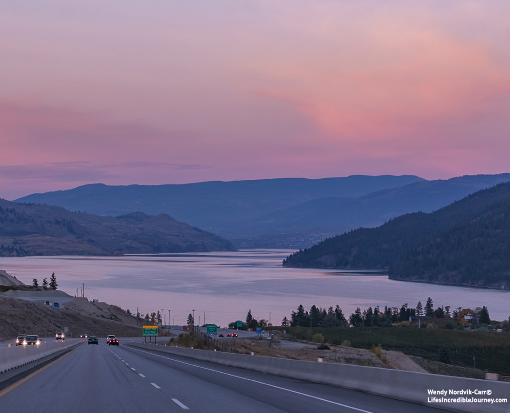 Travel British Columbia on the best BC road trip from Vancouver - First view of the Okanagan Lake driving down the Coquihalla Highway into the Okanagan Valley. Photo Credit: Wendy Nordvik-Carr©