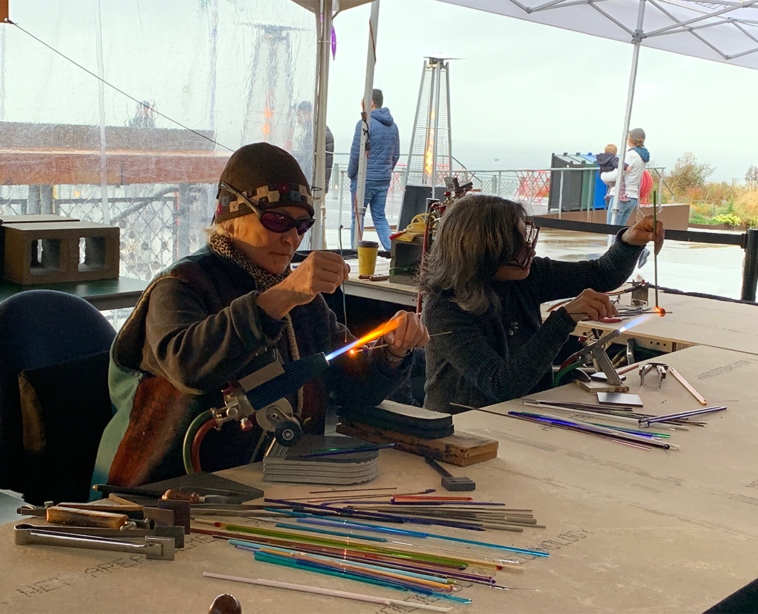 Refract Seattle Glass Artists at Pike Place Market demonstrate flame worked glass art.