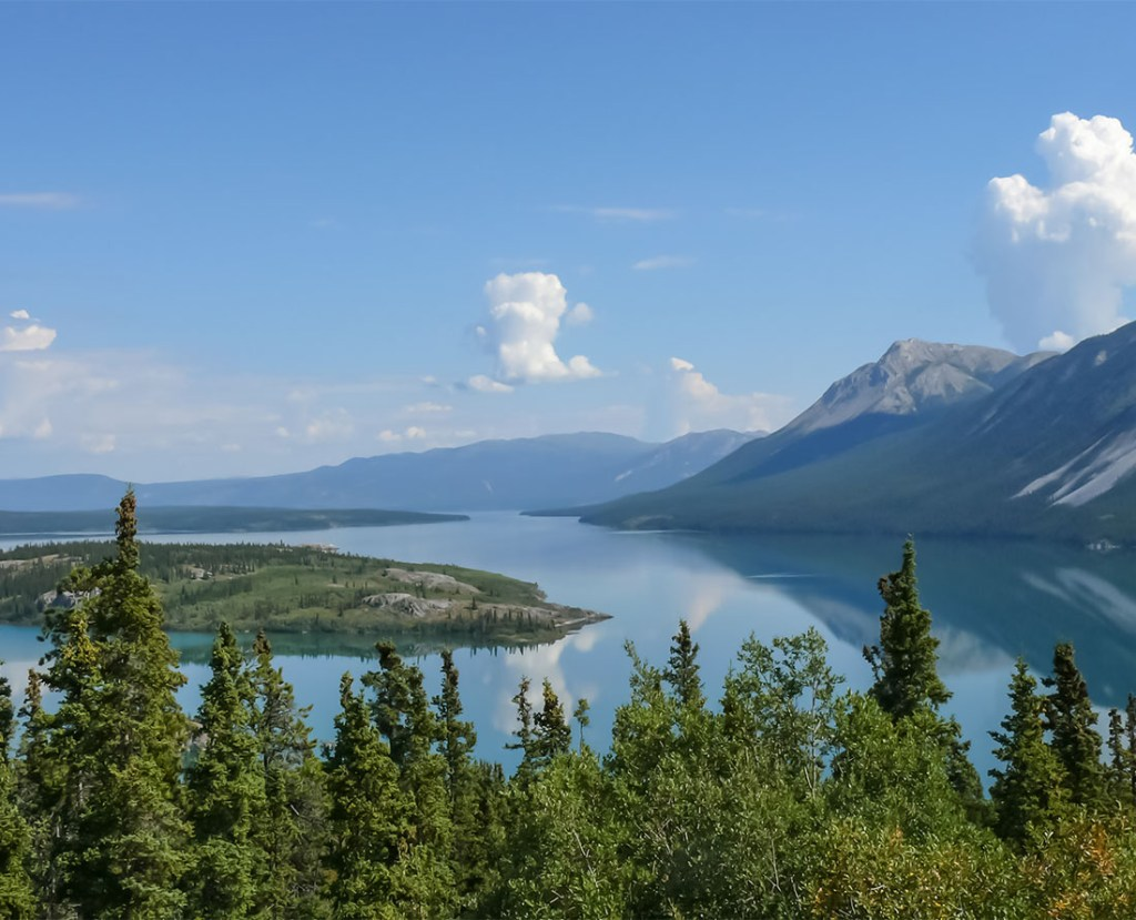 Top scenic drive in Canada. View of Bove Island on Tagish Lake. This view is at Km 95 of the South Klondike Highway between Skagway, Alaska and Carcross, Yukon. Discover the breathtaking scenery of the Yukon wilderness.