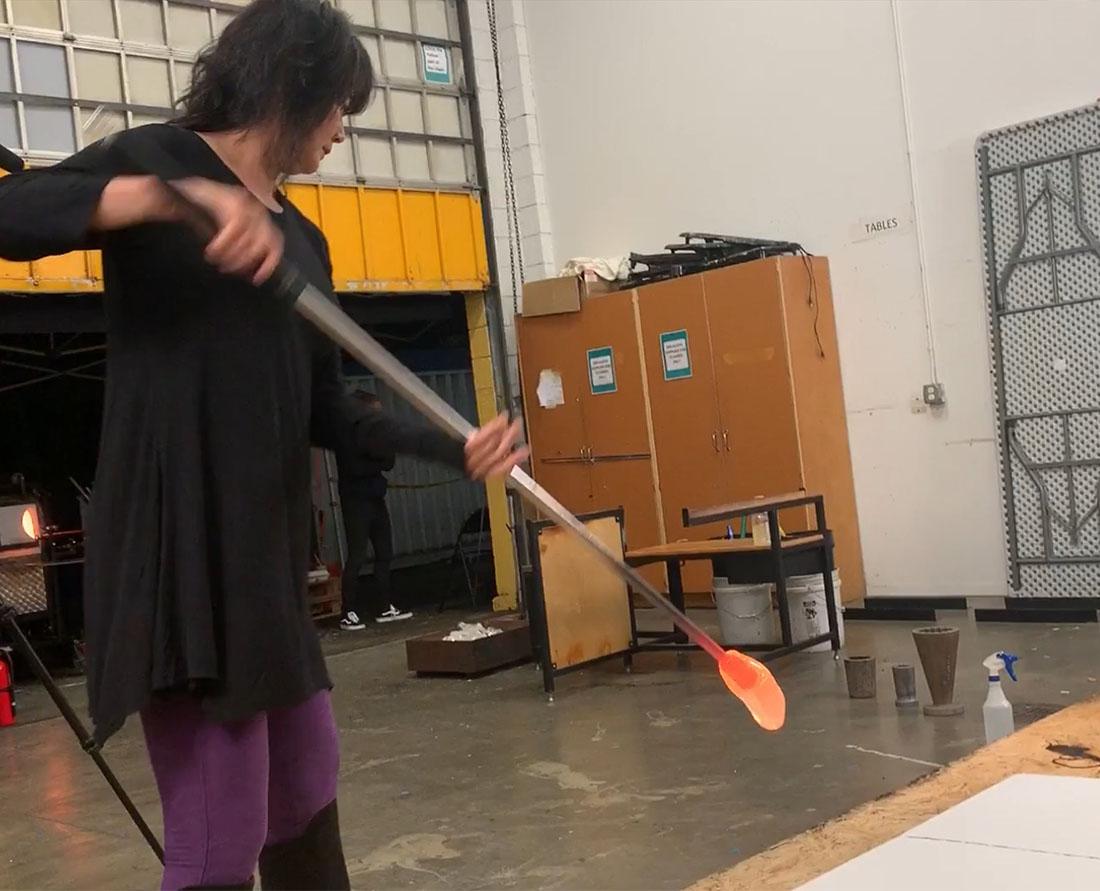 Seattle glass artist Etsuko Ichikawa creates her signature glass pyrograph drawing with molten glass demonstration Photo Wendy Nordvik-Carr