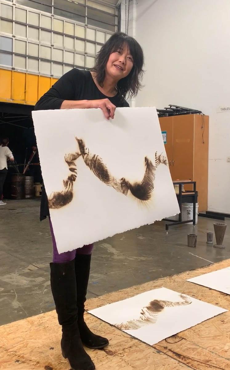 Seattle glass artist Etsuko Ichikawa creates her signature glass pyrograph paintings with molten glass demonstration.Photo: Wendy Nordvik-Carr©