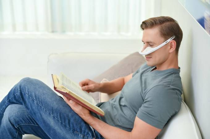 nLED_stock_image_man_using_device_and_reading