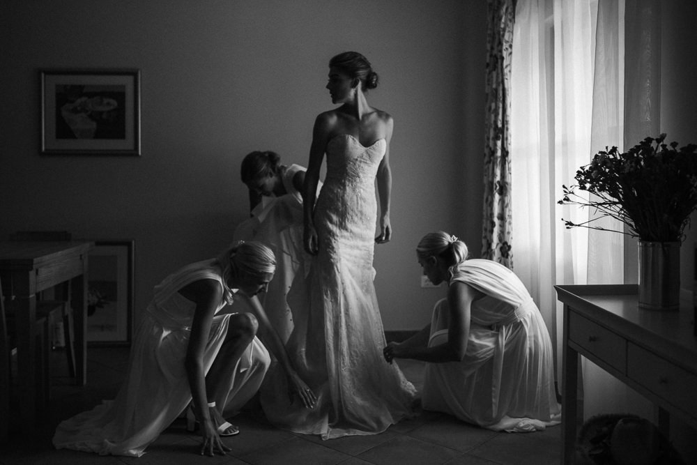 Bride and bridesmaid getting ready on her wedding day in Hvar