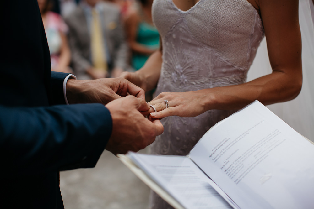 Bride and Groom during their ceremony in Saint Mark Church in Hvar in Croatia ring exchange