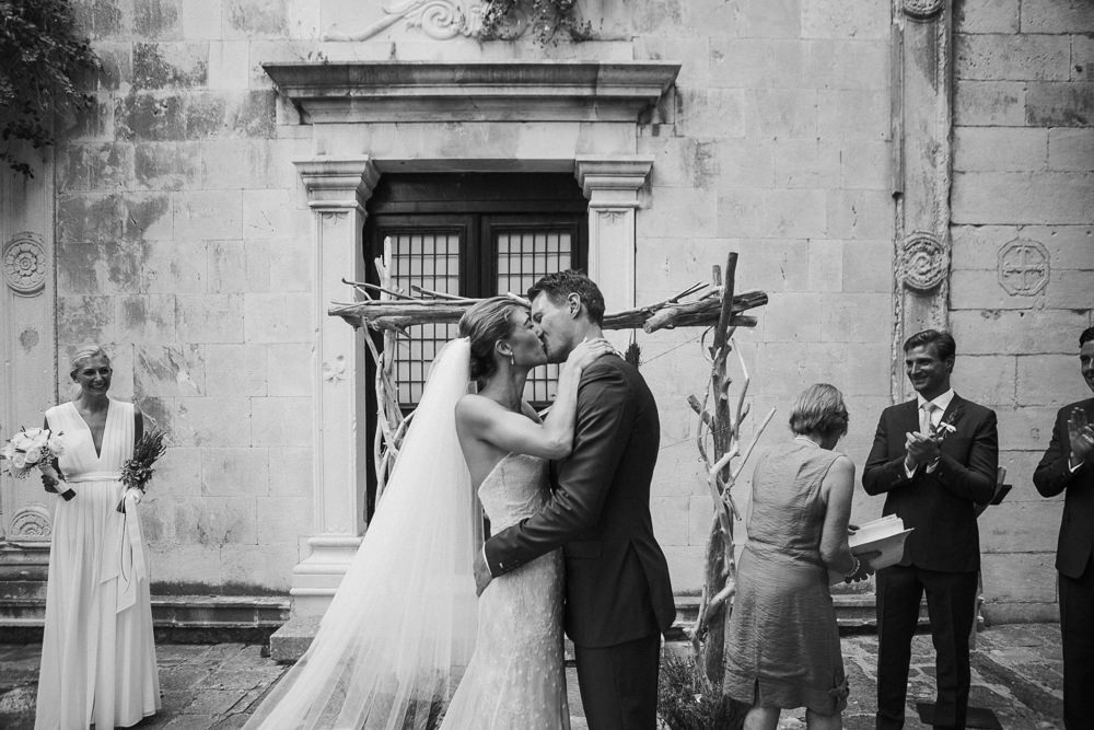 Bride and groom first kiss after the ceremony in Saint Mark church in Hvar in Croatia
