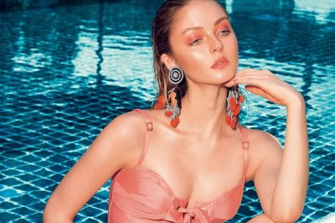 'Tallulah' lace-up maillot in Amalfi, Agua Brazilian Swimwear; 'Por do Sol' beaded earrings with pompoms, Sepa x Agua