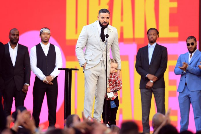 Drake Accepts Artist Of The Decade Award With Son Adonis At 2021 Billboard Music Awards