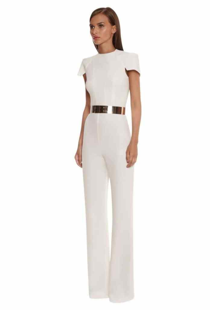lady wearing white jumpsuit with gold belt
