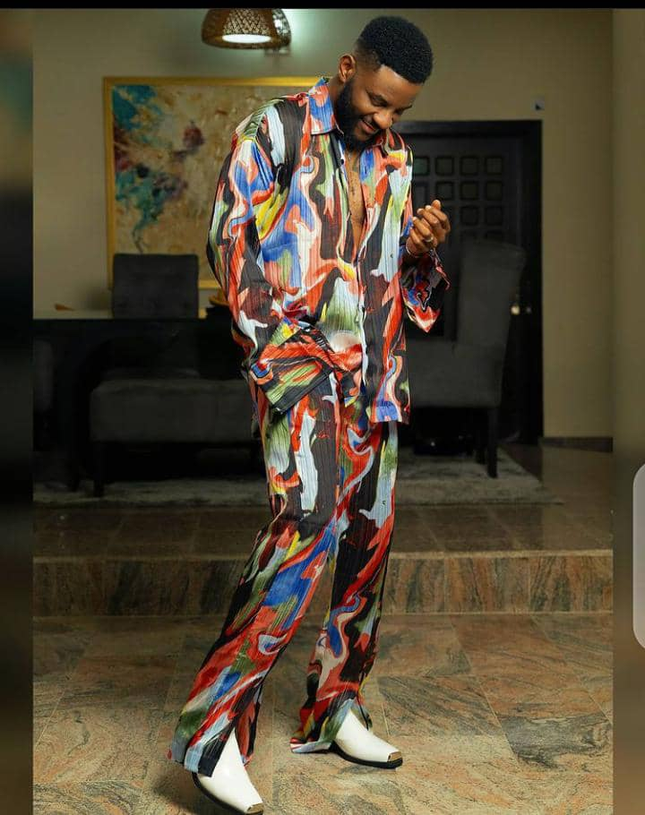 Ebuka wearing colorful outfit with white shoes