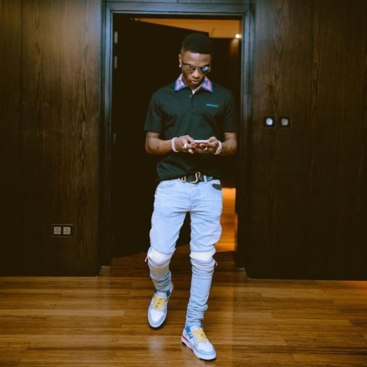 Wizkid stepping out in a streetwear style