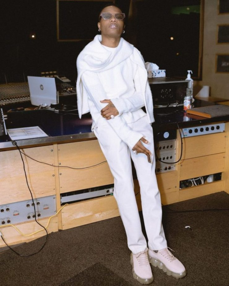 Machala dripping in an all-white outfit