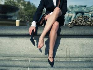 Woman Taking of High Heel