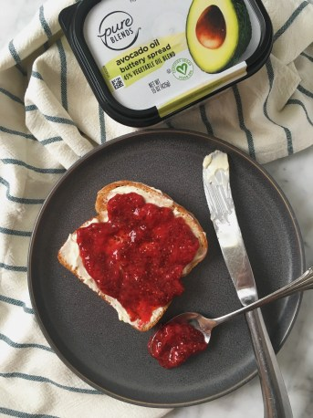 strawberry jam with chia seeds on toast with plant based butter