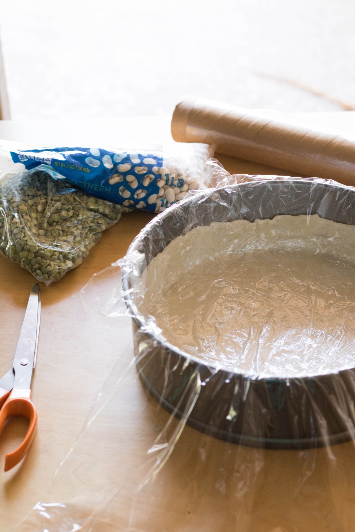 lining the pie crust before baking