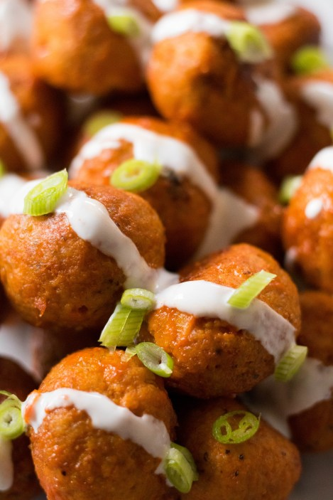 Chicken buffalo meat balls with ranch and onions on top