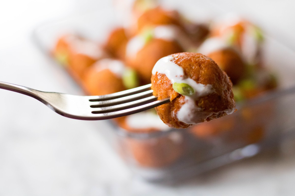 Chicken buffalo meat balls in a fork close up