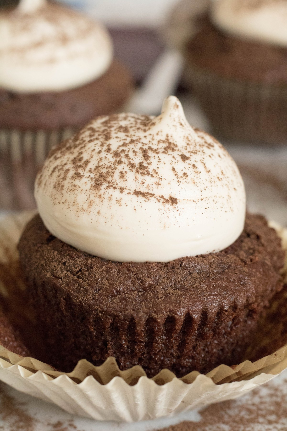 Cream cheese frosting on chocolate cupcake