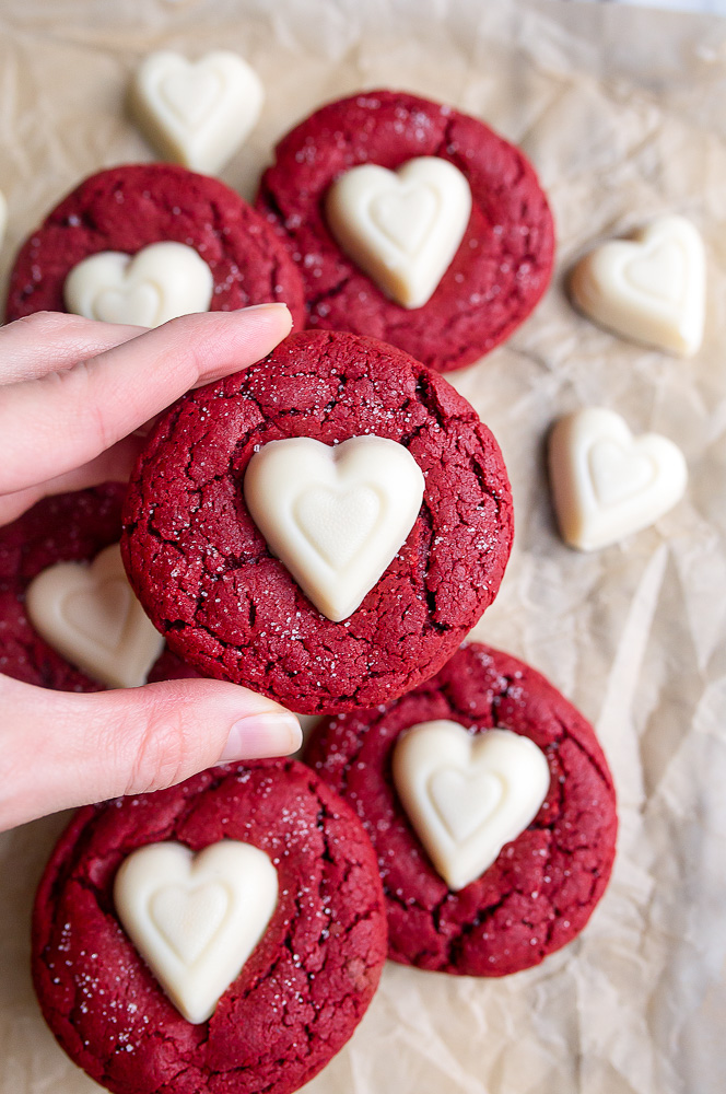 Red velvet sugar cookies with hearts on top for the best valentine's day cookie ideas