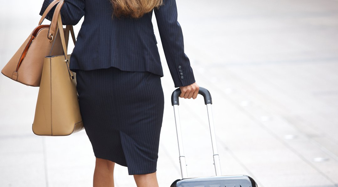 Bringing the 401k home to Canada. A story of Financial Success. Businesswoman traveling with luggage and handbags.