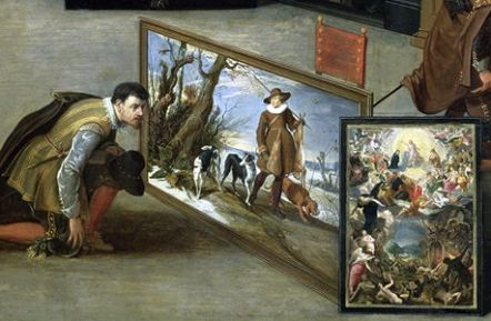 man looking at paintings