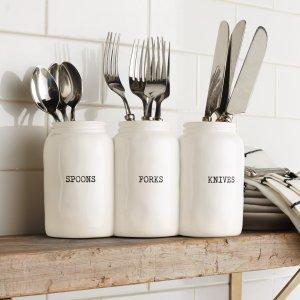 "Mud Pie <a href=""https://lifestylesgiftware.com/product/ceramic-utensil-holder-by-mud-pie/"" target=""_blank"" rel=""noopener noreferrer"">Ceramic Utensil Holder</a>"